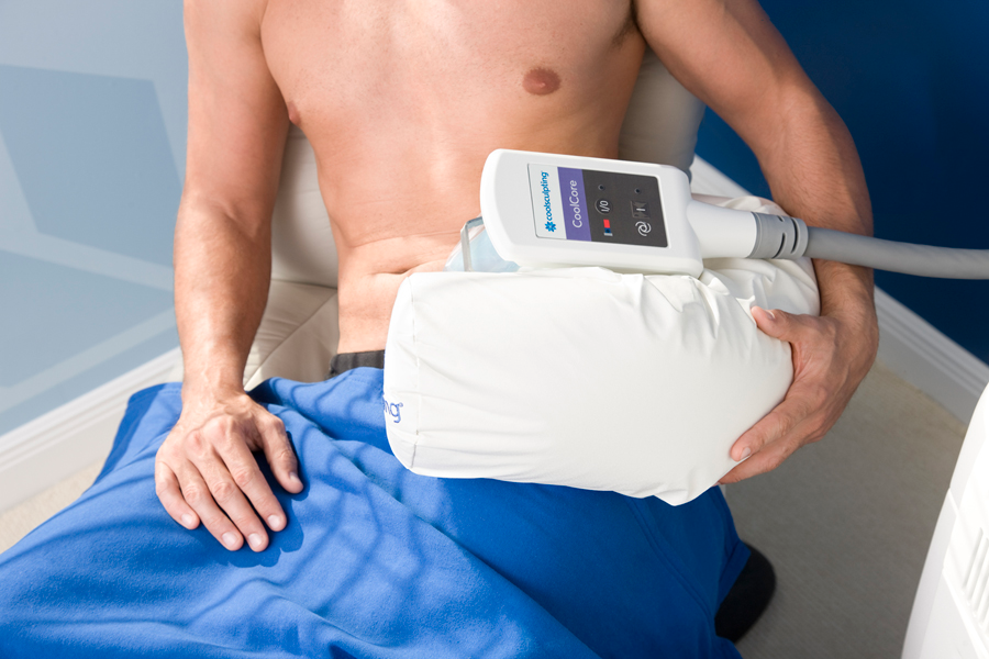 Male patient being treated by CoolSculpting on his flanks